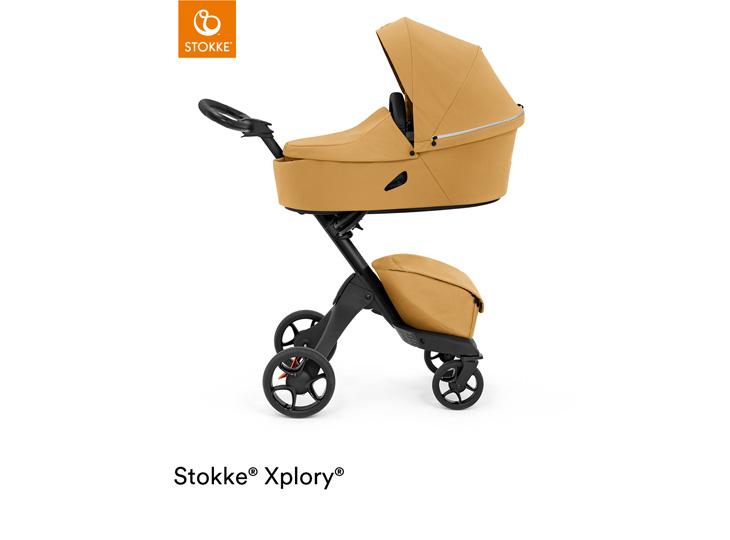 Stokke® Xplory X Golden Yellow met reiswieg